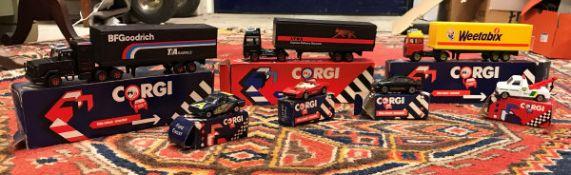A box containing various Corgi boxed veh