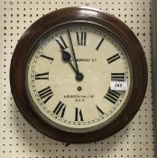 A late 19th Century wall clock, the whit