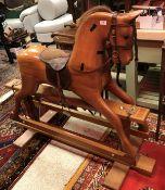 A modern wooden rocking horse by G.N. Ma