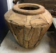 A modern teak urn
