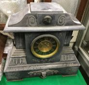 A Victorian black marble cased mantle cl