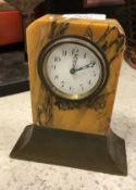 An Art Deco mantel clock, the white enam