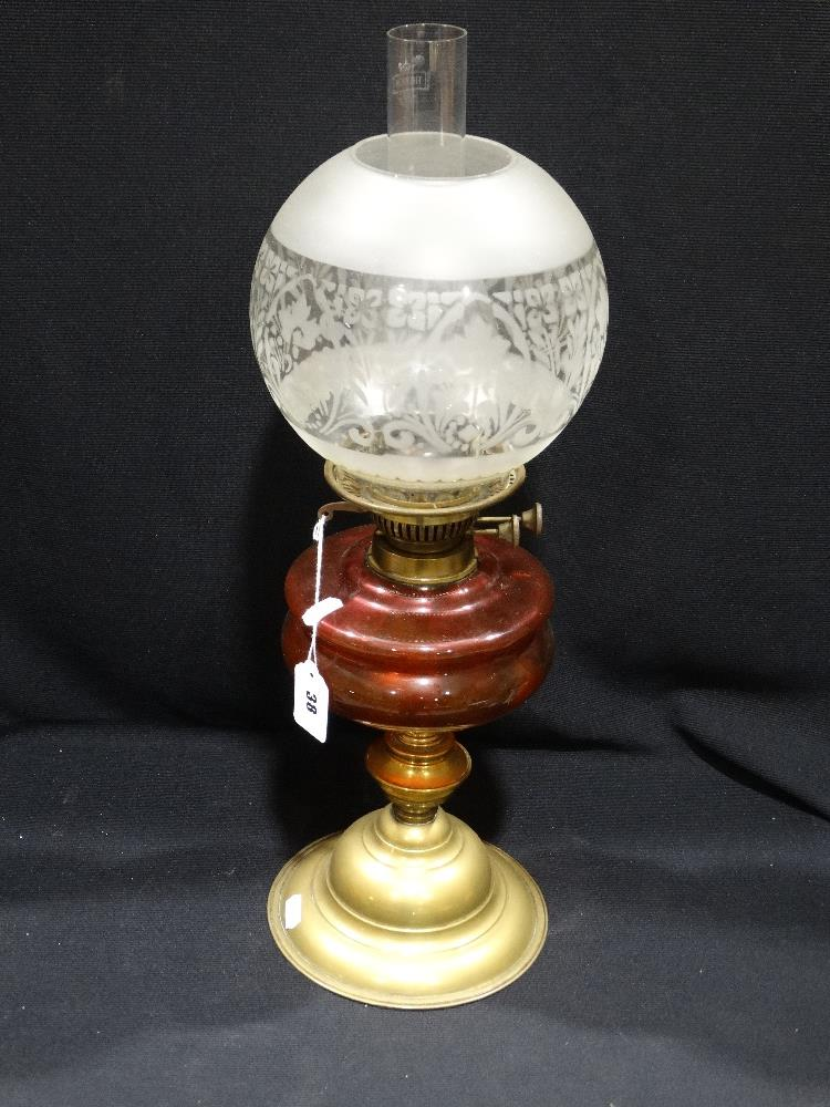 Lot 38 - A Circular Based Brass Column Oil Lamp With Cranberry Tinted Reservoir