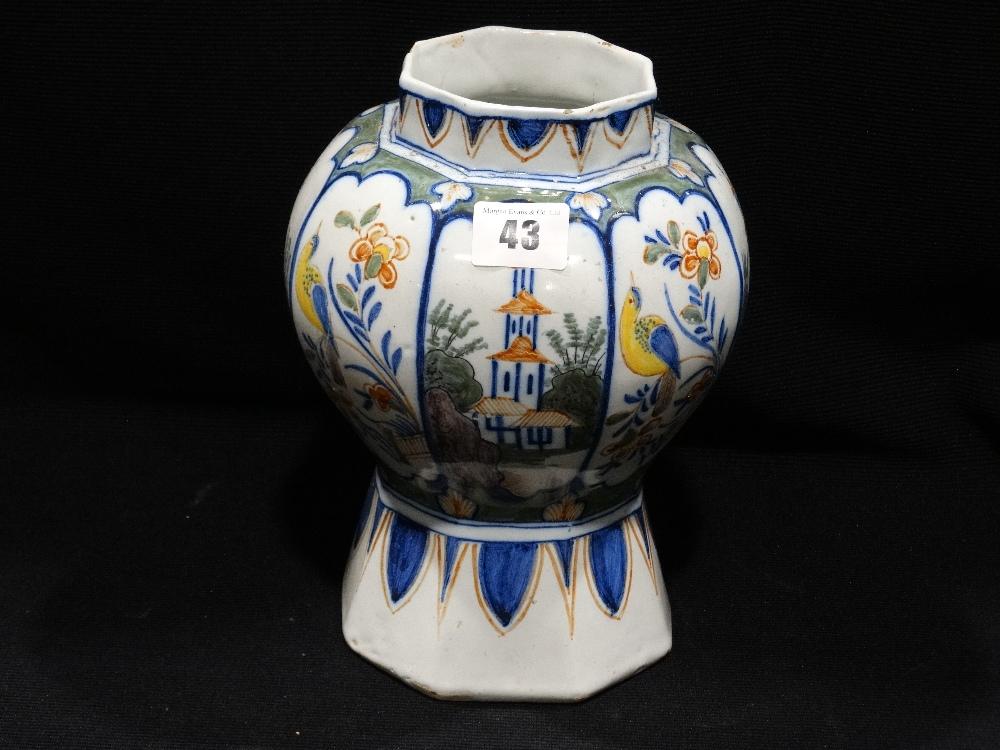 "Lot 43 - An Octagonal Based Delft Pottery Vase With Bird Floral & Landscape Panels, 9"" High"
