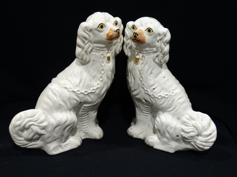 Lot 51 - A Pair Of Staffordshire Pottery White Seated Dogs