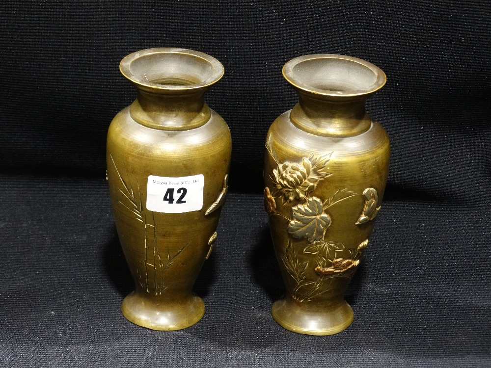 Lot 42 - A Pair Of Oriental Bronze Circular Based Baluster Vases, Relief Decorated With Gold & Silver