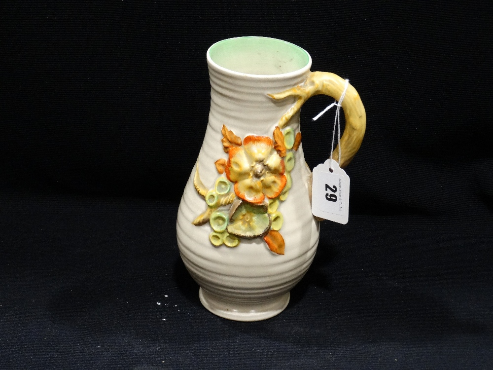 "Lot 29 - A Moulded Clarice Cliff Floral Decorated Jug, 8.5"" High"
