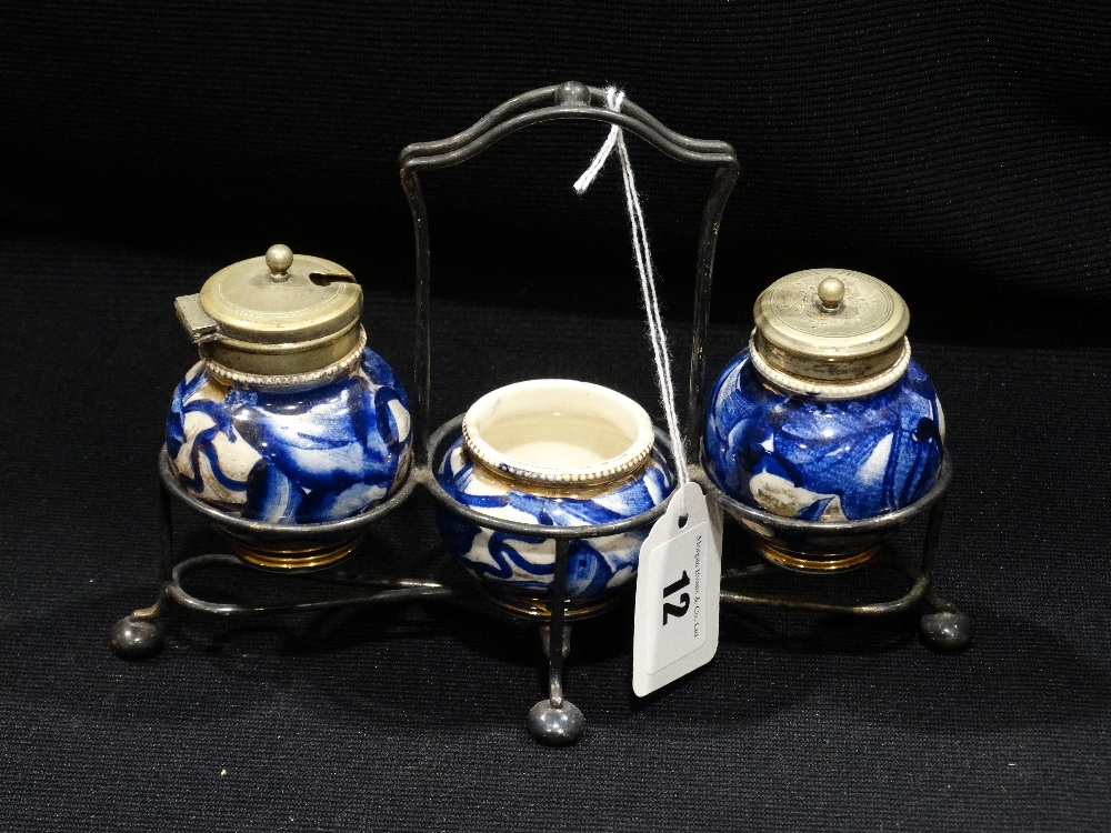 Lot 12 - An Early 20th Century Blue & White Transfer Decorated Three Piece Condiment Set Within A Plated