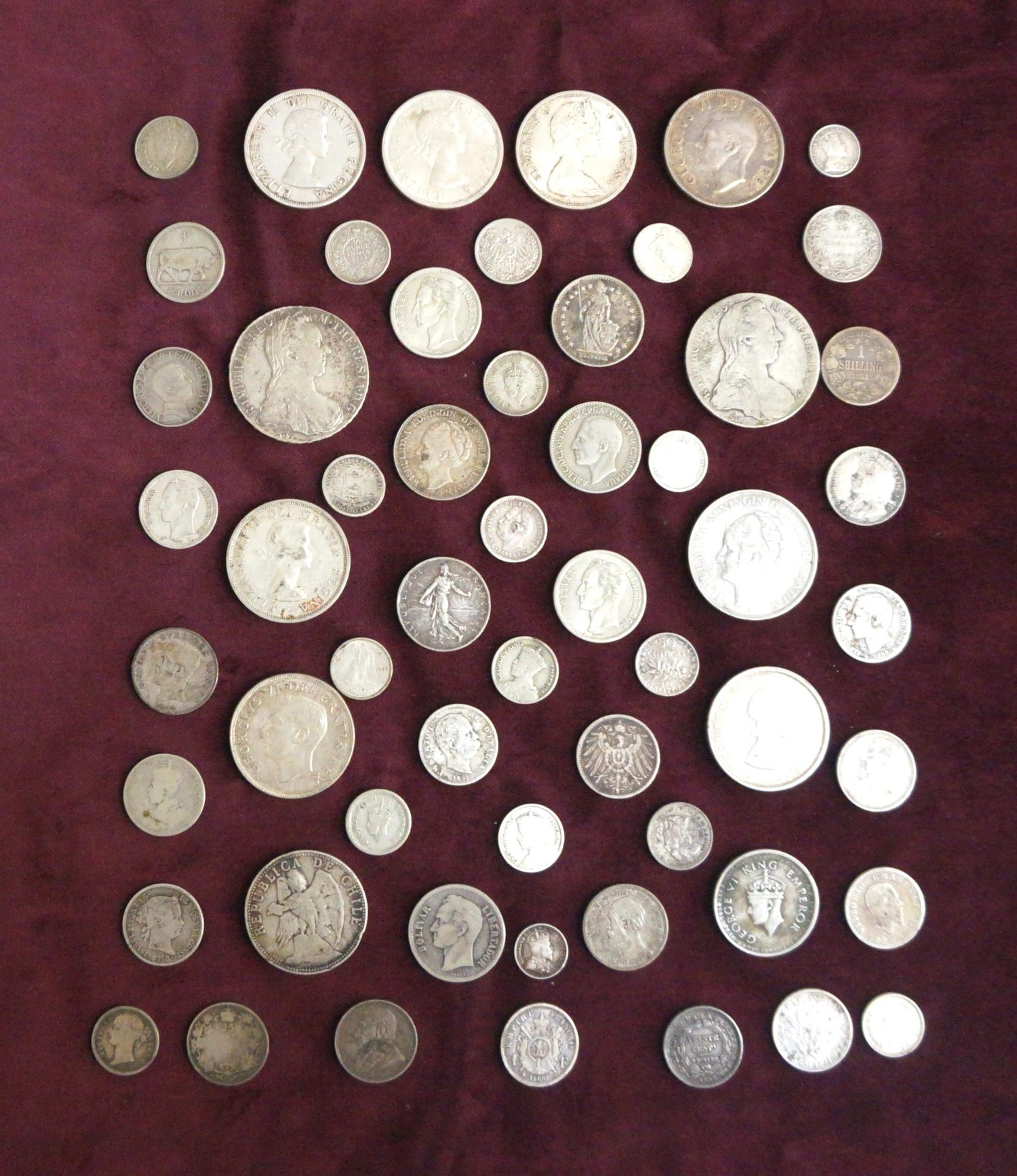 Lot 365 - SELECTION OF WORLD SILVER COINS silver content ranging from .925 to .500, including two Maria