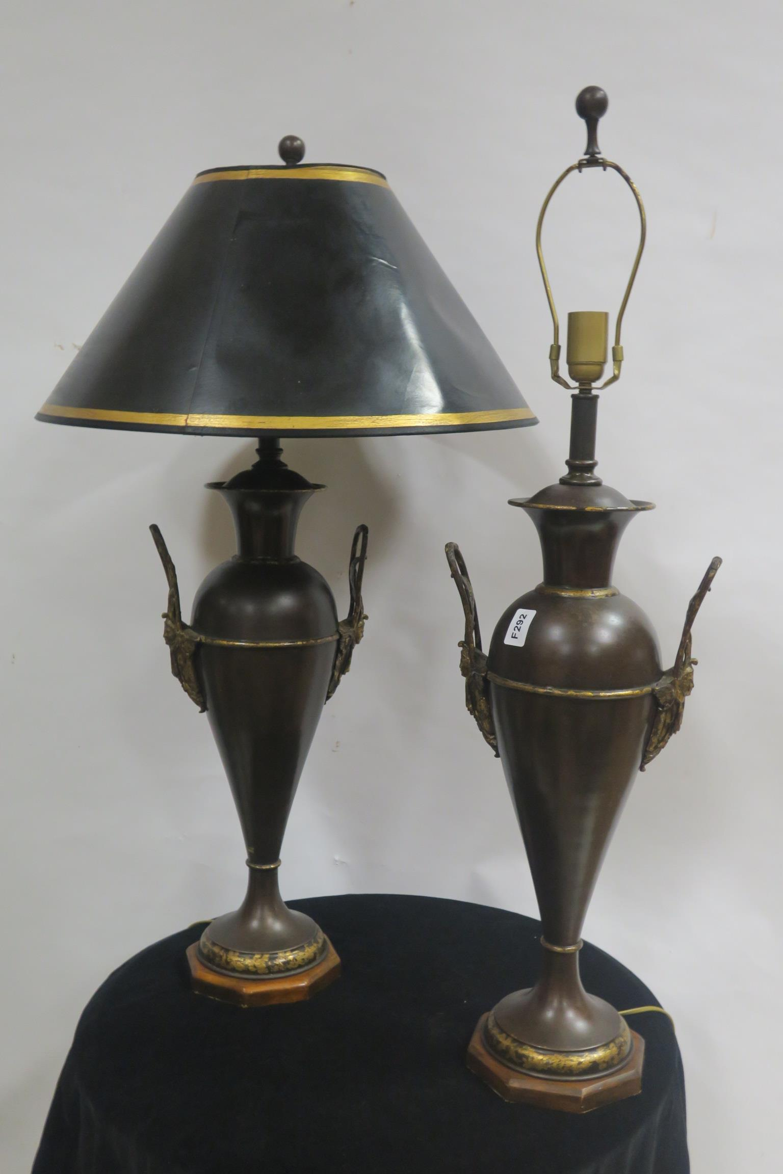 Lot 123 - A PAIR OF BRONZED AND GILT BRASS TABLE LAMPS each of urn form with mask and scroll handles raised