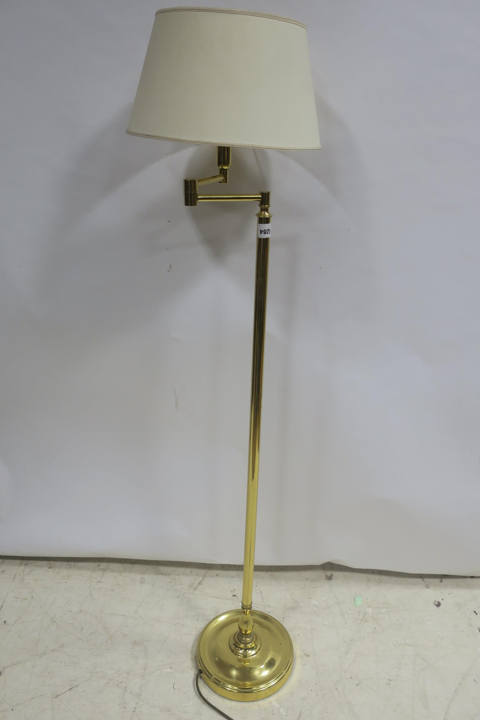 Lot 36 - A BRASS ADJUSTABLE FLOOR STANDARD LAMP the cylindrical column on a circular spreading foot together