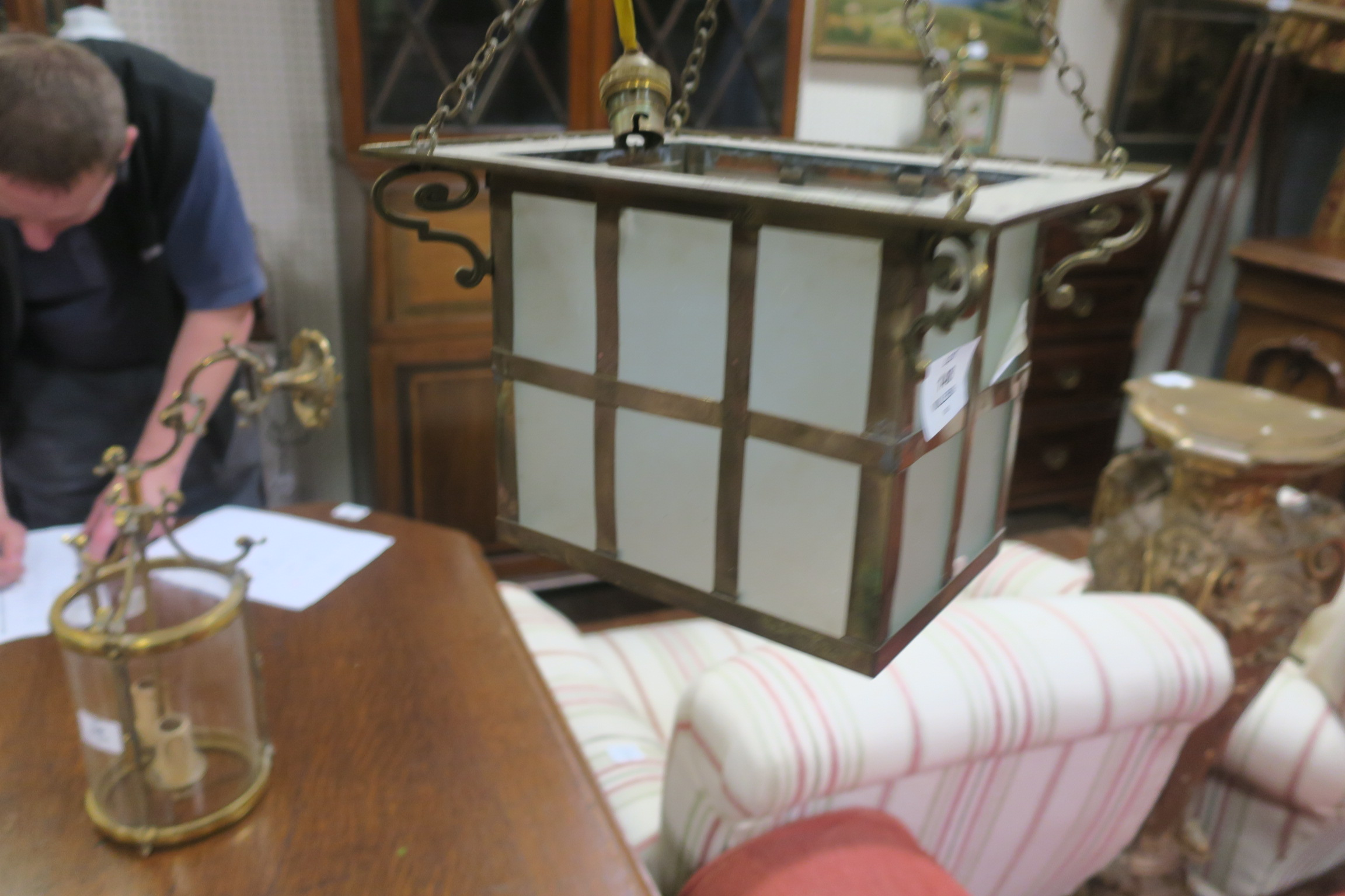 Lot 654 - A CIRCA 1950s BRASS AND FROSTED GLASS SINGLE LIGHT HALL LANTERN of square form with scroll