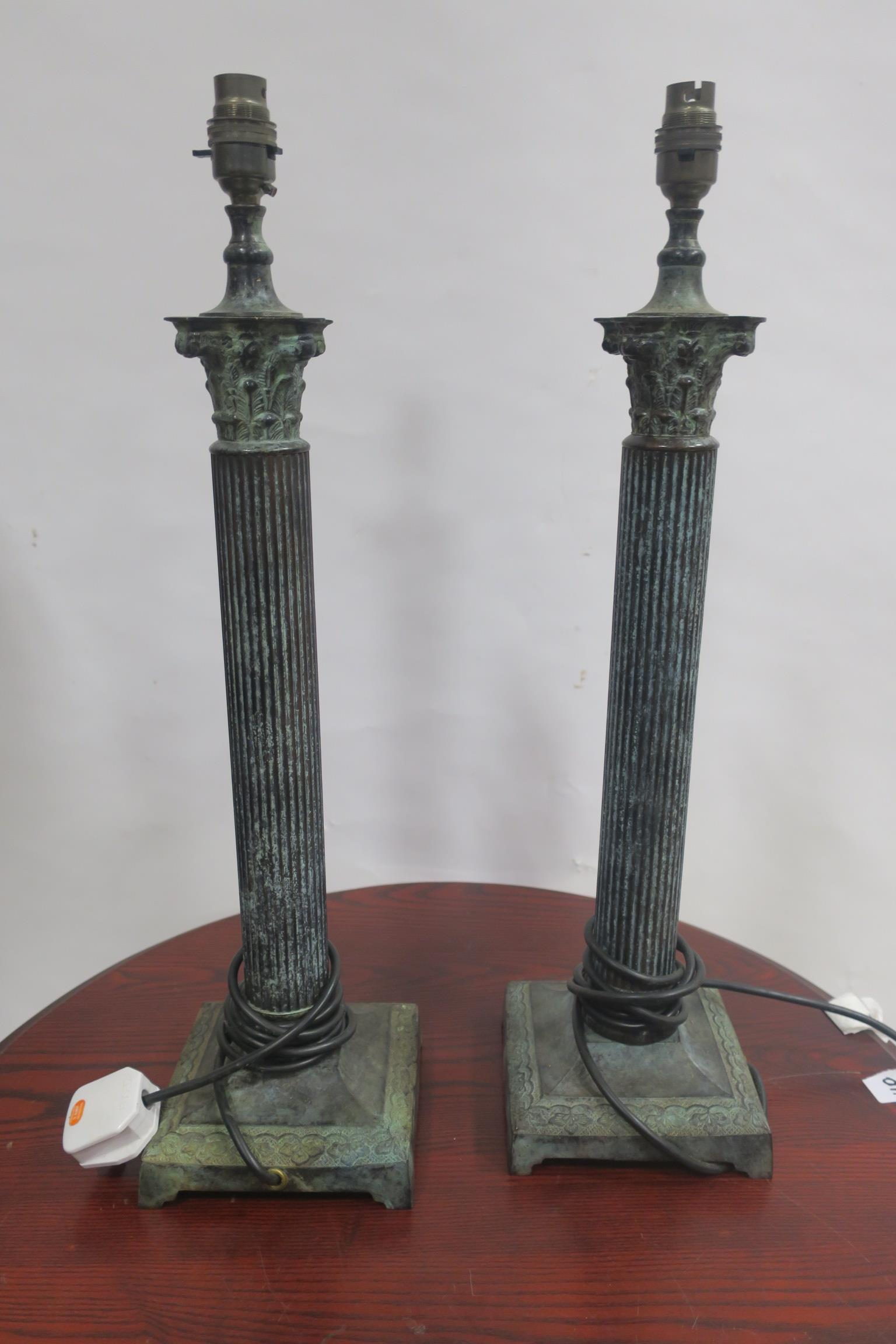 Lot 528 - A PAIR OF BRONZE PATENATED TABLE LAMPS,