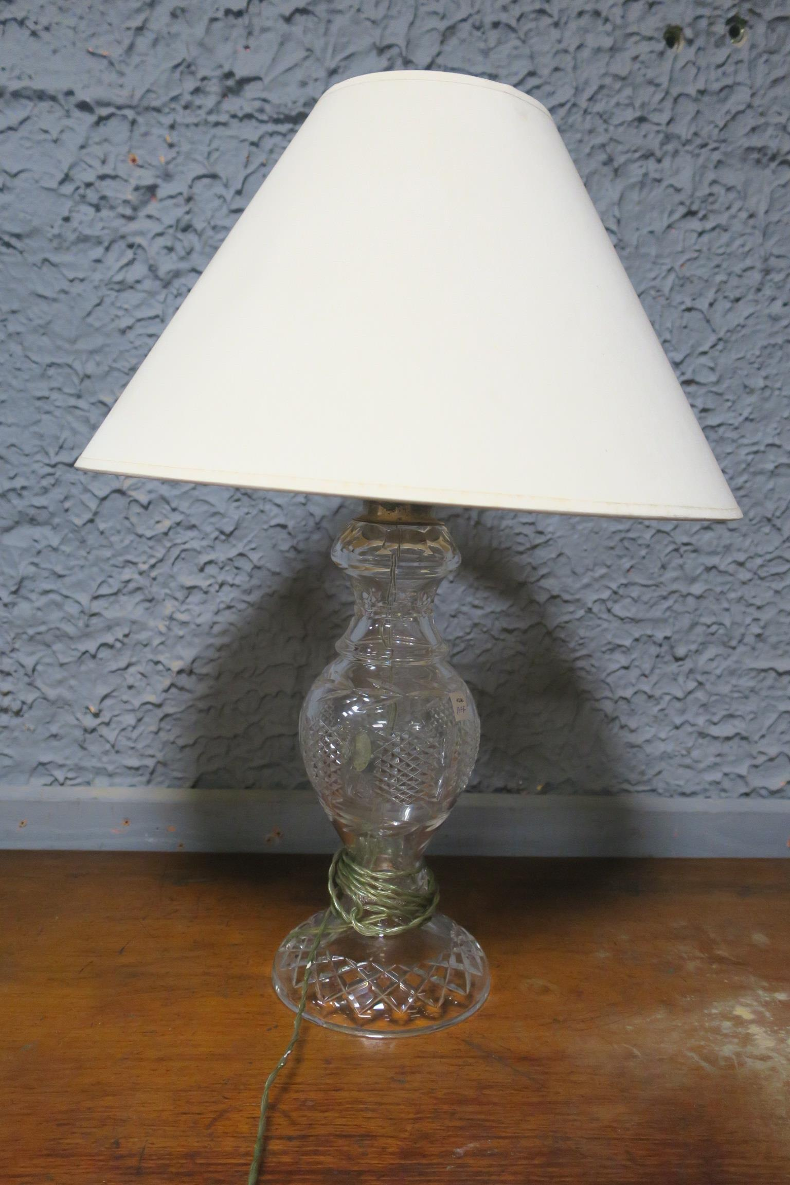 Lot 475 - A CUT GLASS TABLE LAMP,
