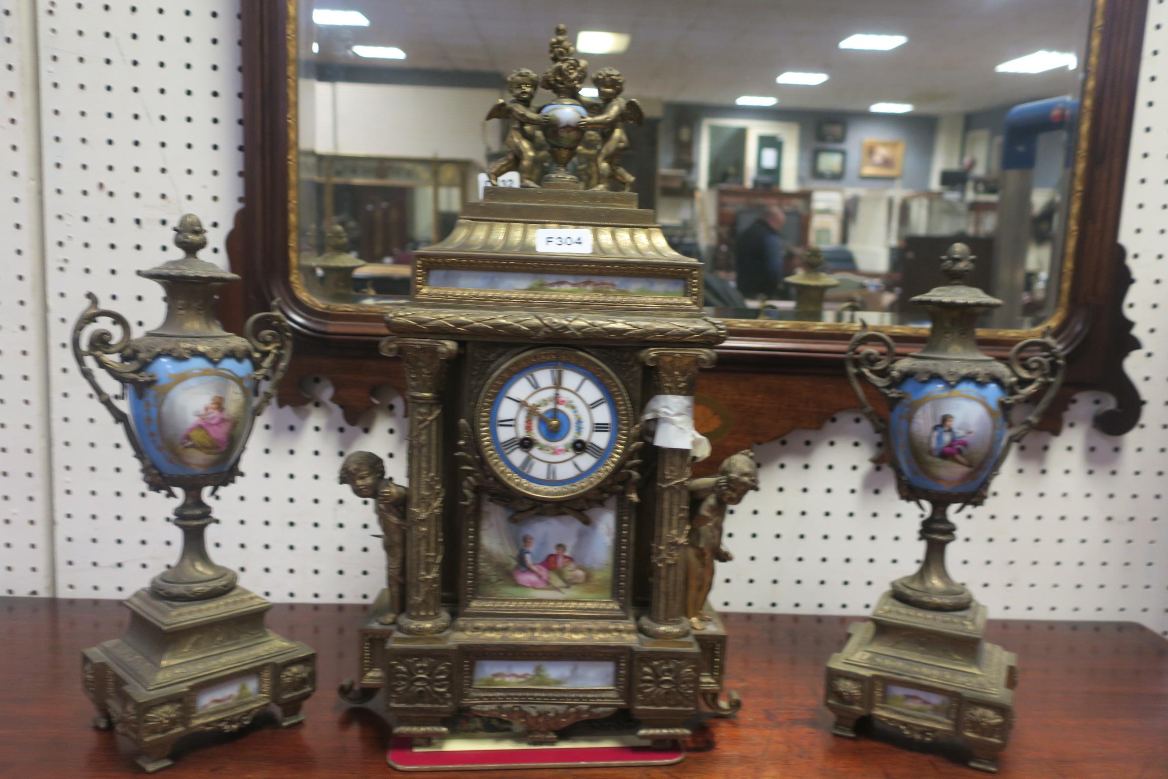 Lot 198 - A 19th CENTURY GILT METAL AND PORCELAIN CLOCK GARNITURE,
