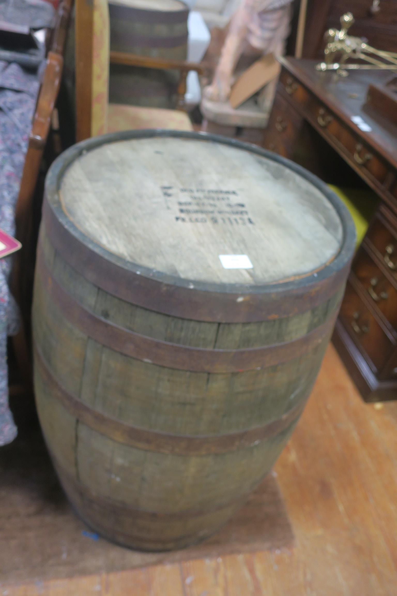 Lot 49 - A PAIR OF OAK AND STEEL BOUND SPIRIT BARRELS inscribed Old Fitzgerald Distillery Bourbon Whiskey