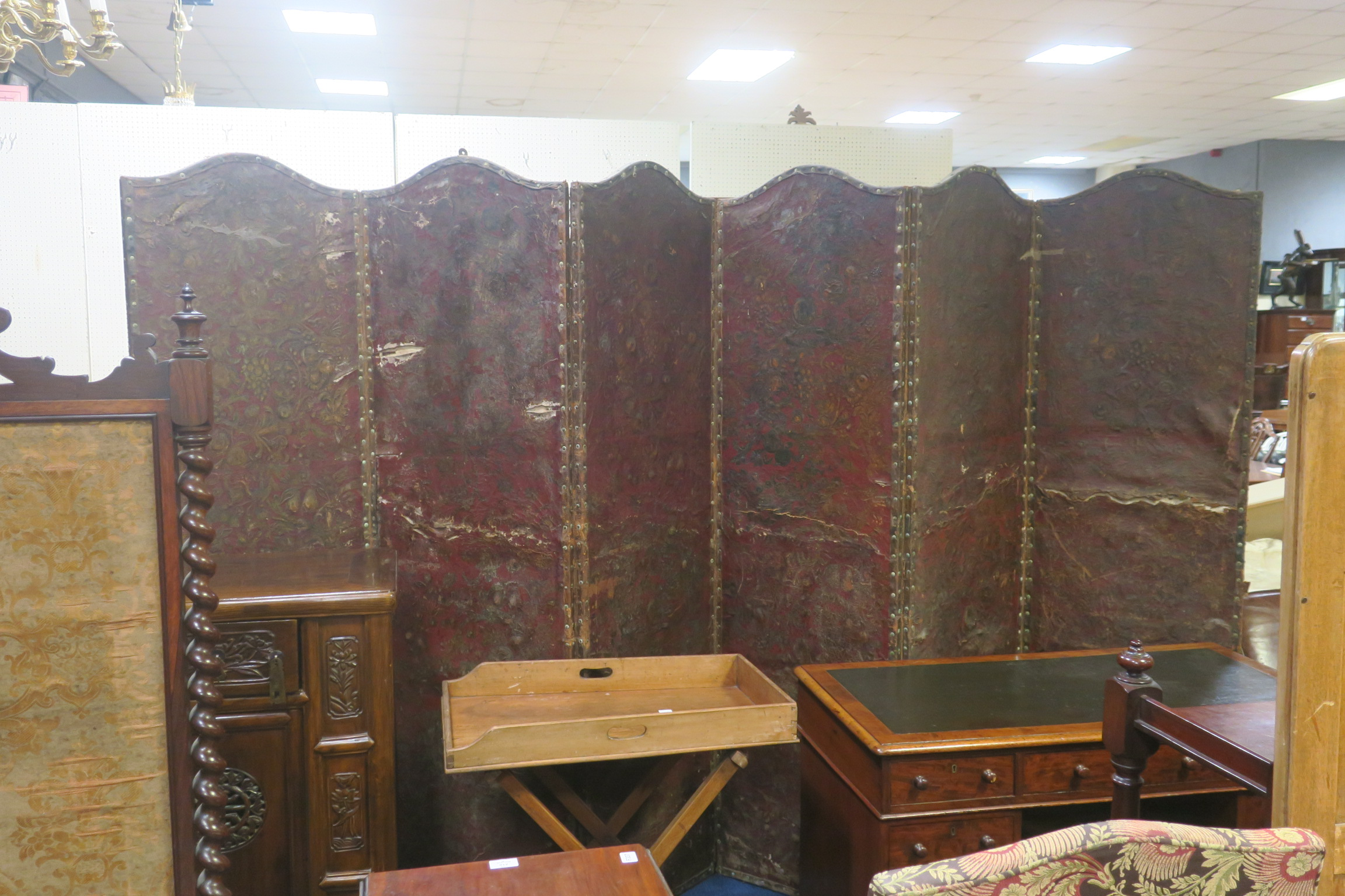 Lot 262 - A 19TH CENTURY HIDE AND POLYCHROME SIX FOLD SCREEN with brass studs 200cm (h) x 342cm (w)