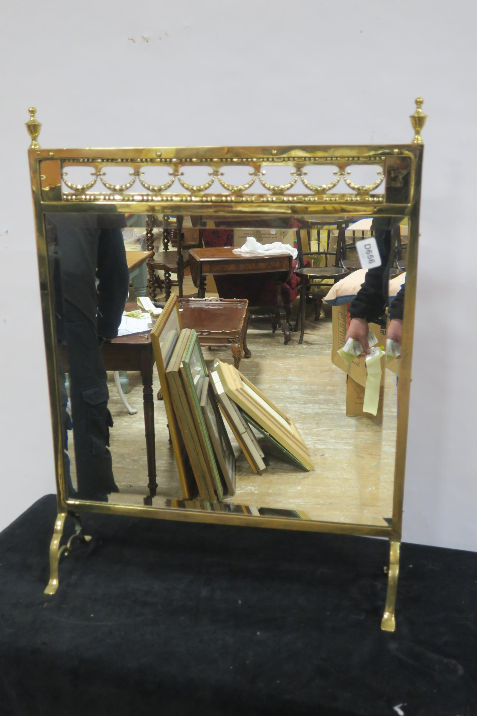Lot 441 - A 19TH CENTURY BRASS MIRRORED FIRE SCREEN the rectangular bevelled glass plate within a moulded