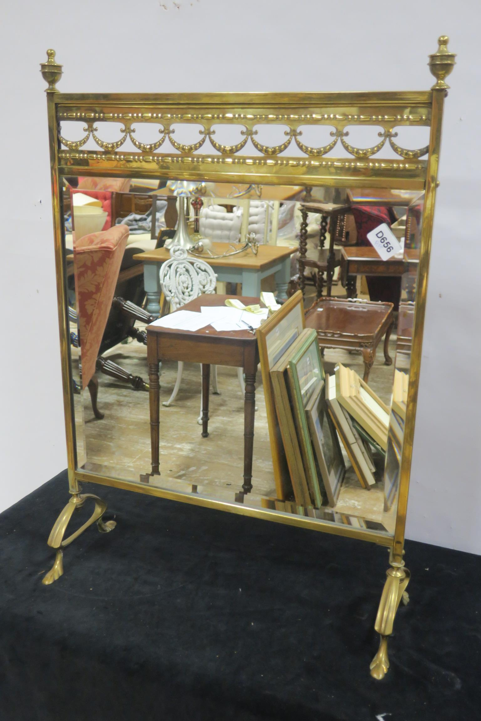 Lot 442 - A 19TH CENTURY BRASS FIRE SCREEN the rectangular bevelled glass plate with pierced cresting and urn