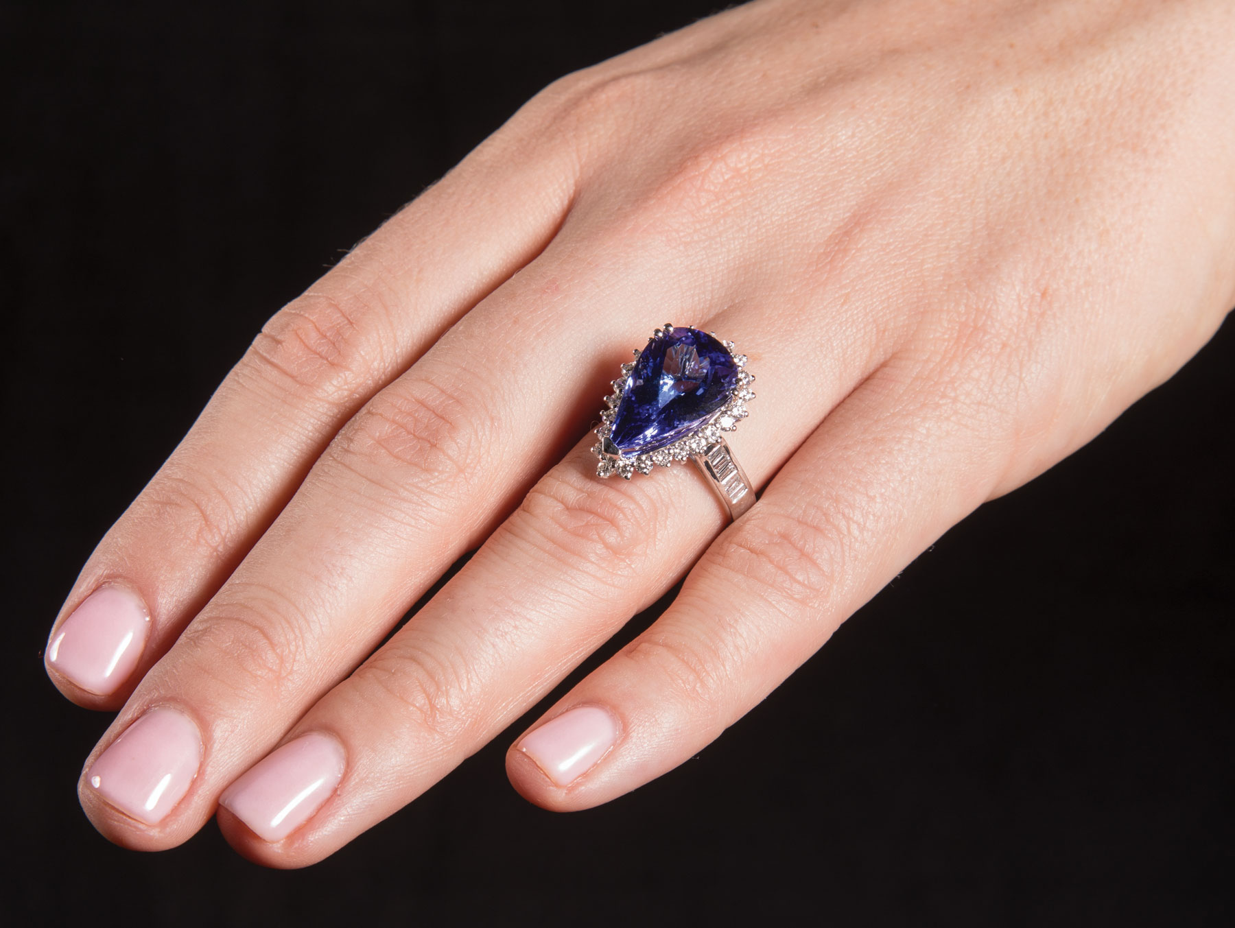 Lot 589 - Platinum, Tanzanite and Diamond Ring , prong set pear shaped modified brilliant cut tanzanite, 17.40