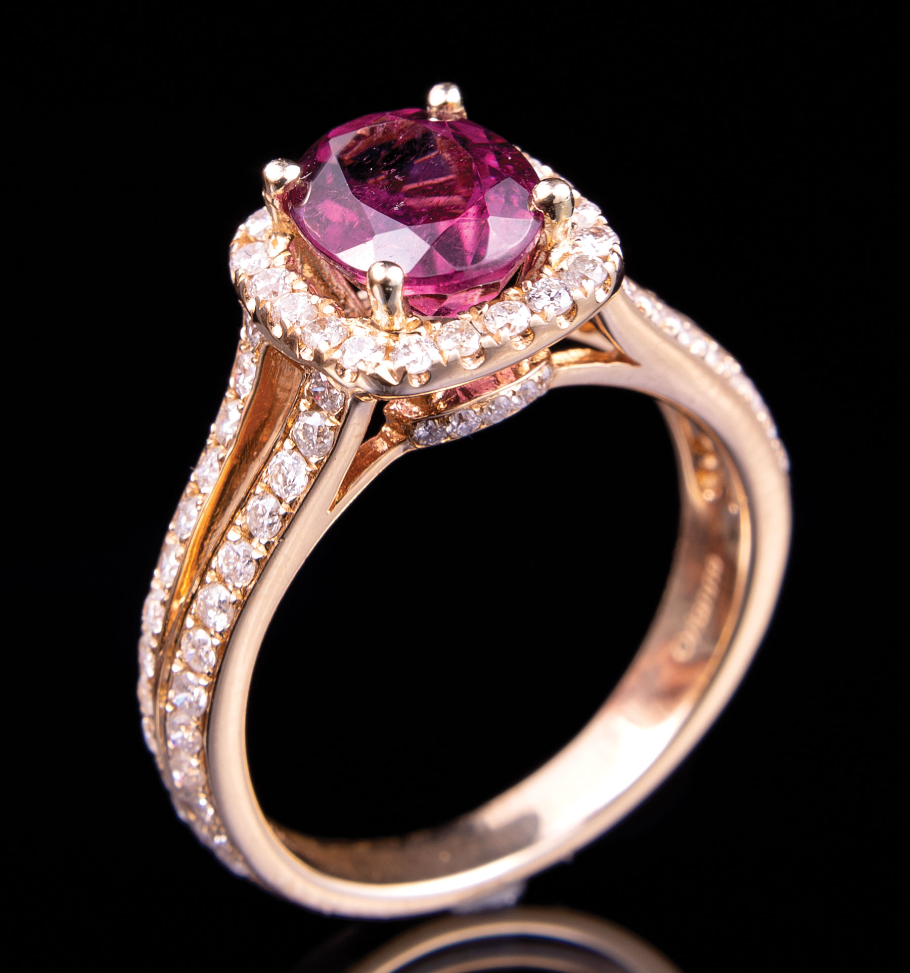 Lot 614 - 14 kt. Yellow Gold, Rubellite and Diamond Ring , prong set oval mixed cut rubellite, 8.50 x 6.80 x