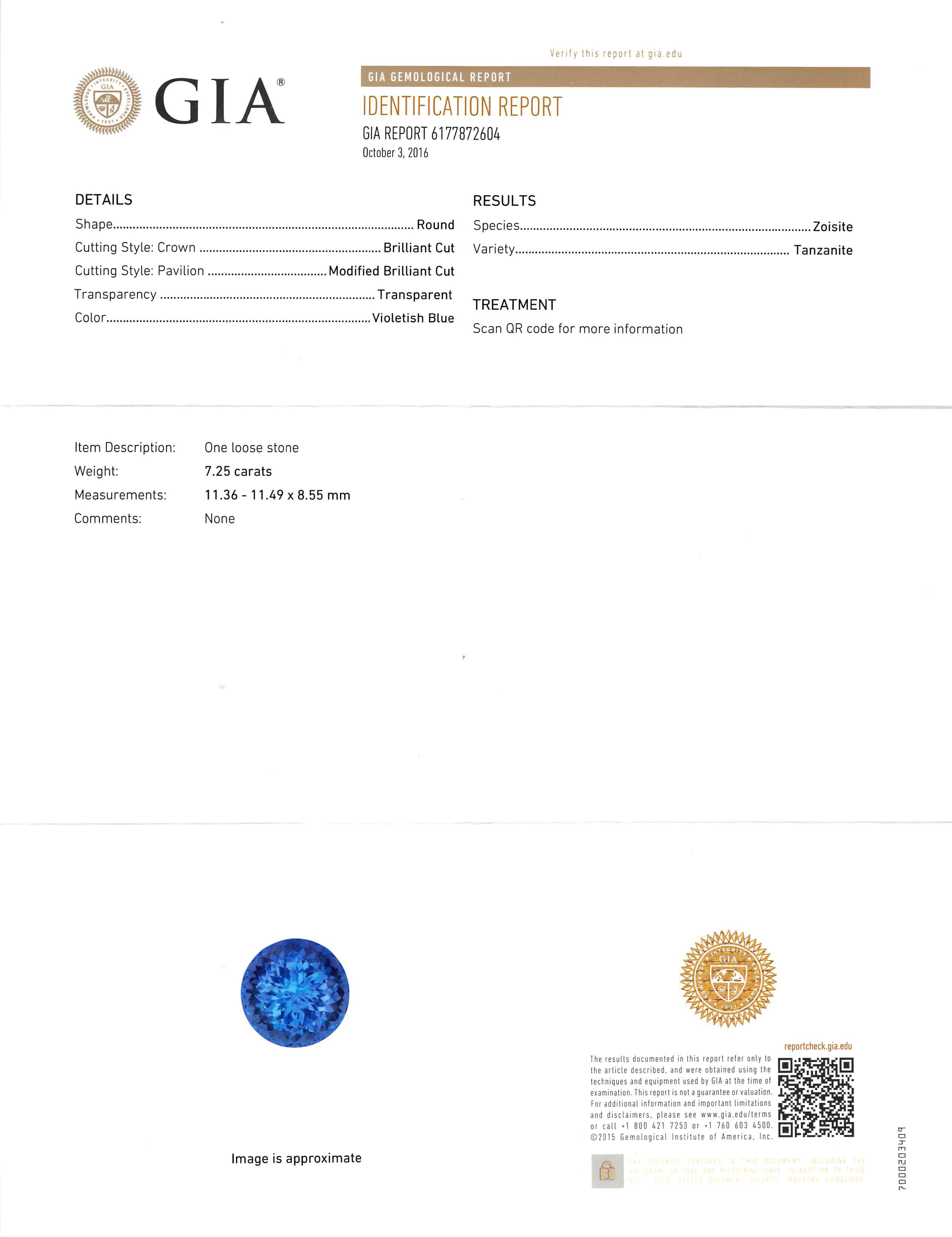 Lot 590 - Platinum, Tanzanite and Diamond Pendant with Platinum Chain , prong set round modified brilliant cut
