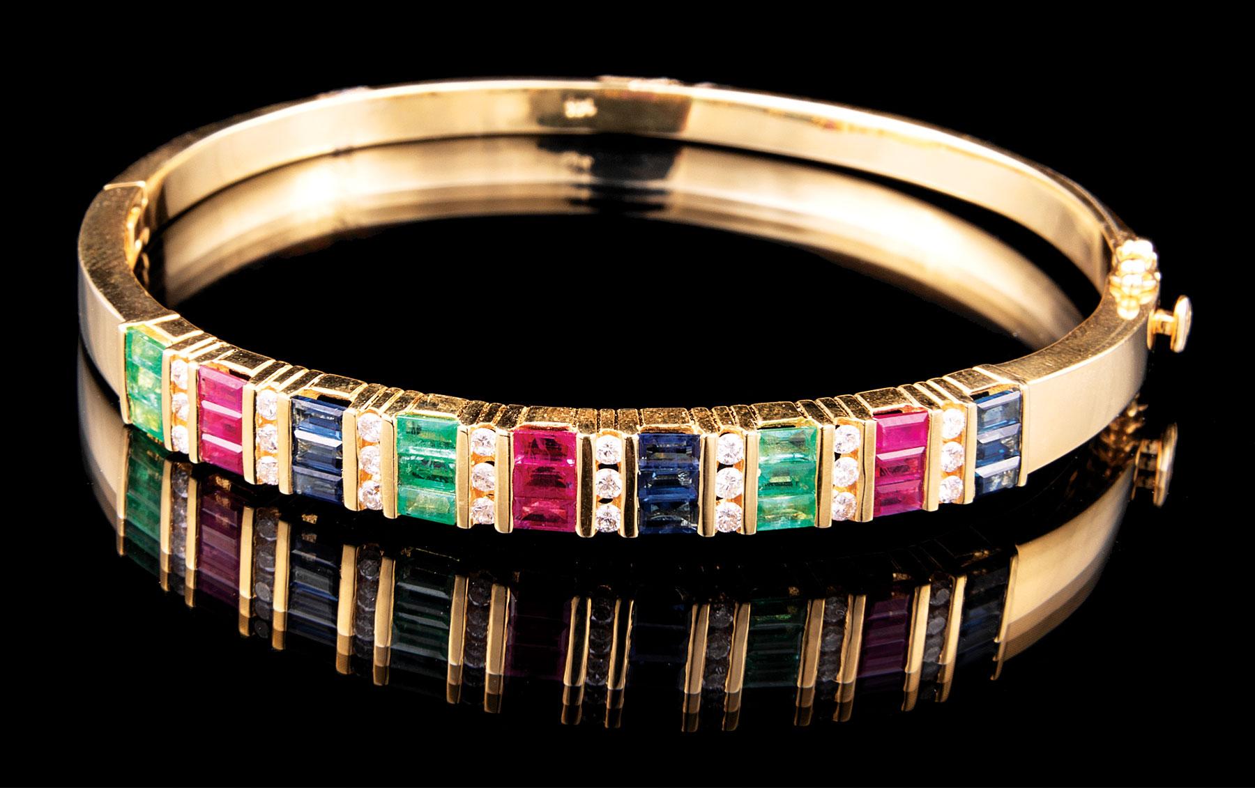 Lot 618 - 14 kt. Yellow Gold, Emerald, Ruby, Blue Sapphire and Diamond Bangle Bracelet , 9 each channel set,
