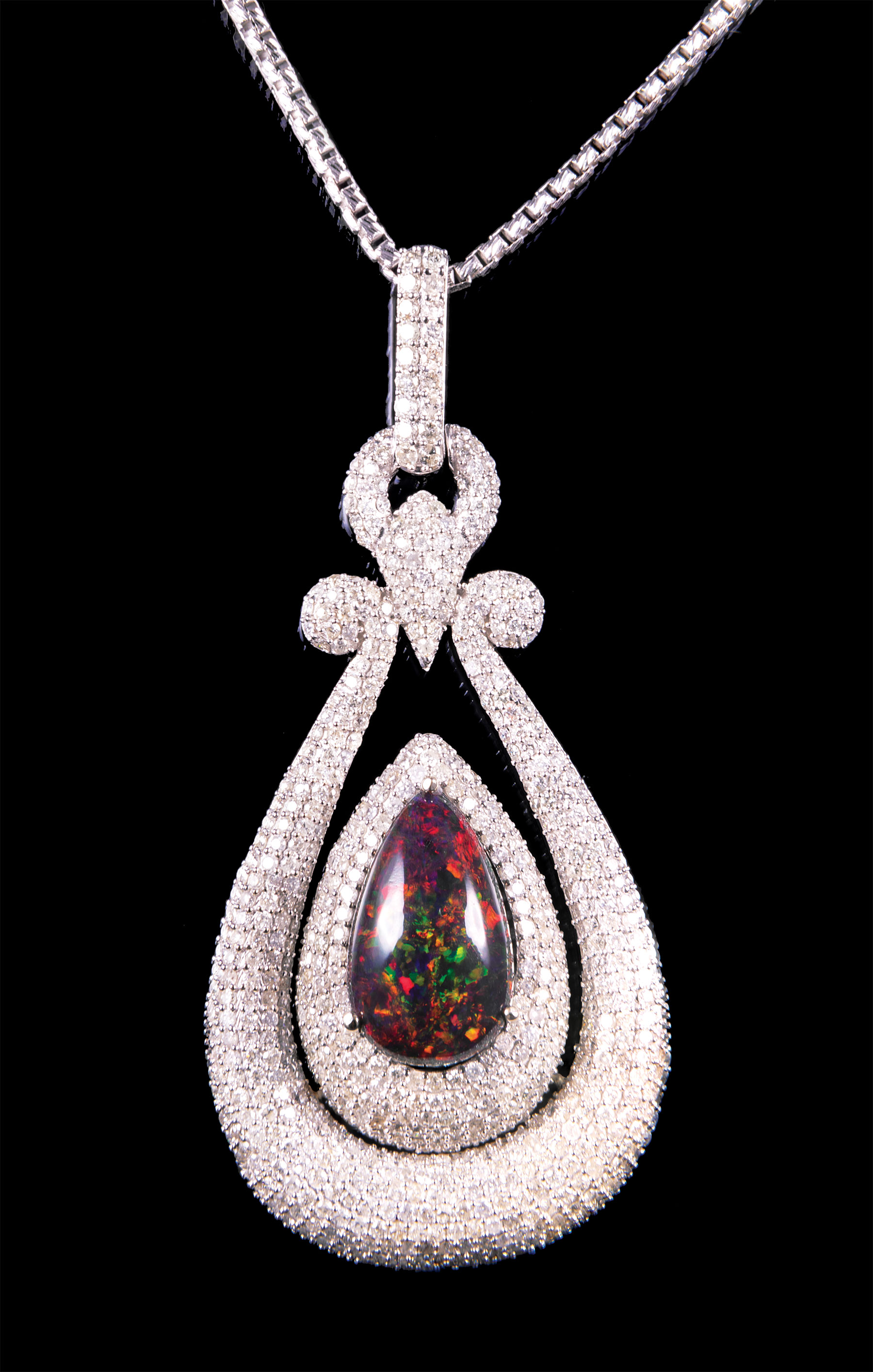 Lot 621 - 14 kt. White Gold, Black Opal and Diamond Pendant with 14 kt. White Gold Chain , prong set pear