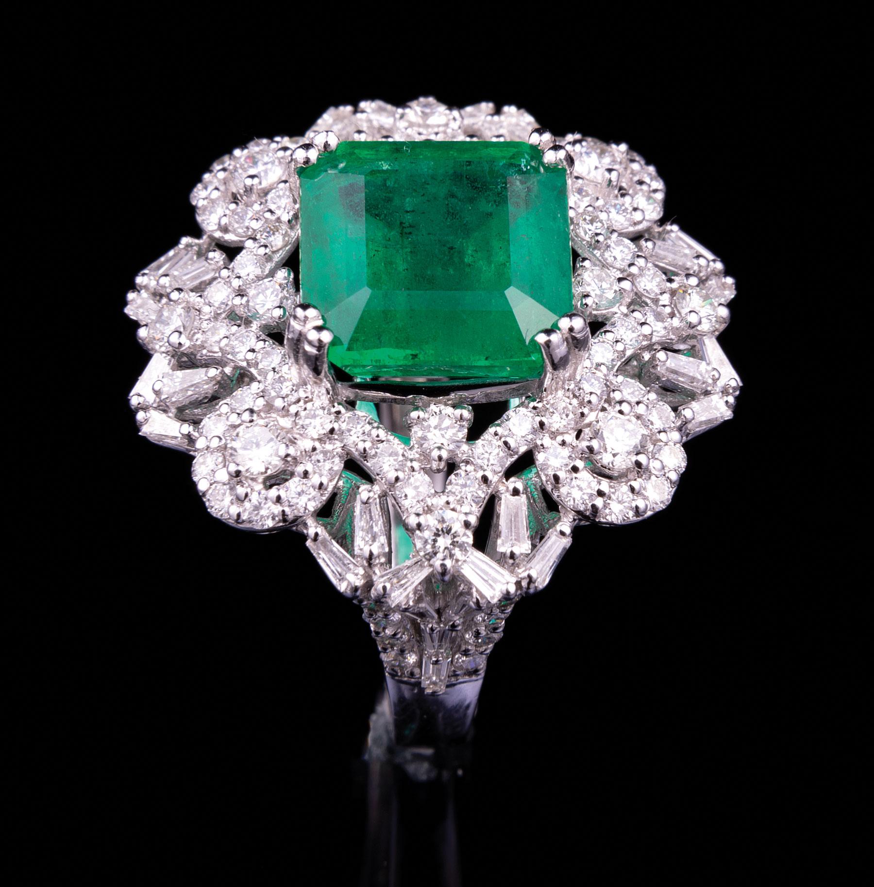 Lot 585 - Platinum, Emerald and Diamond Ring , prong set rectangular step cut natural emerald, 11.39 x 10.81 x