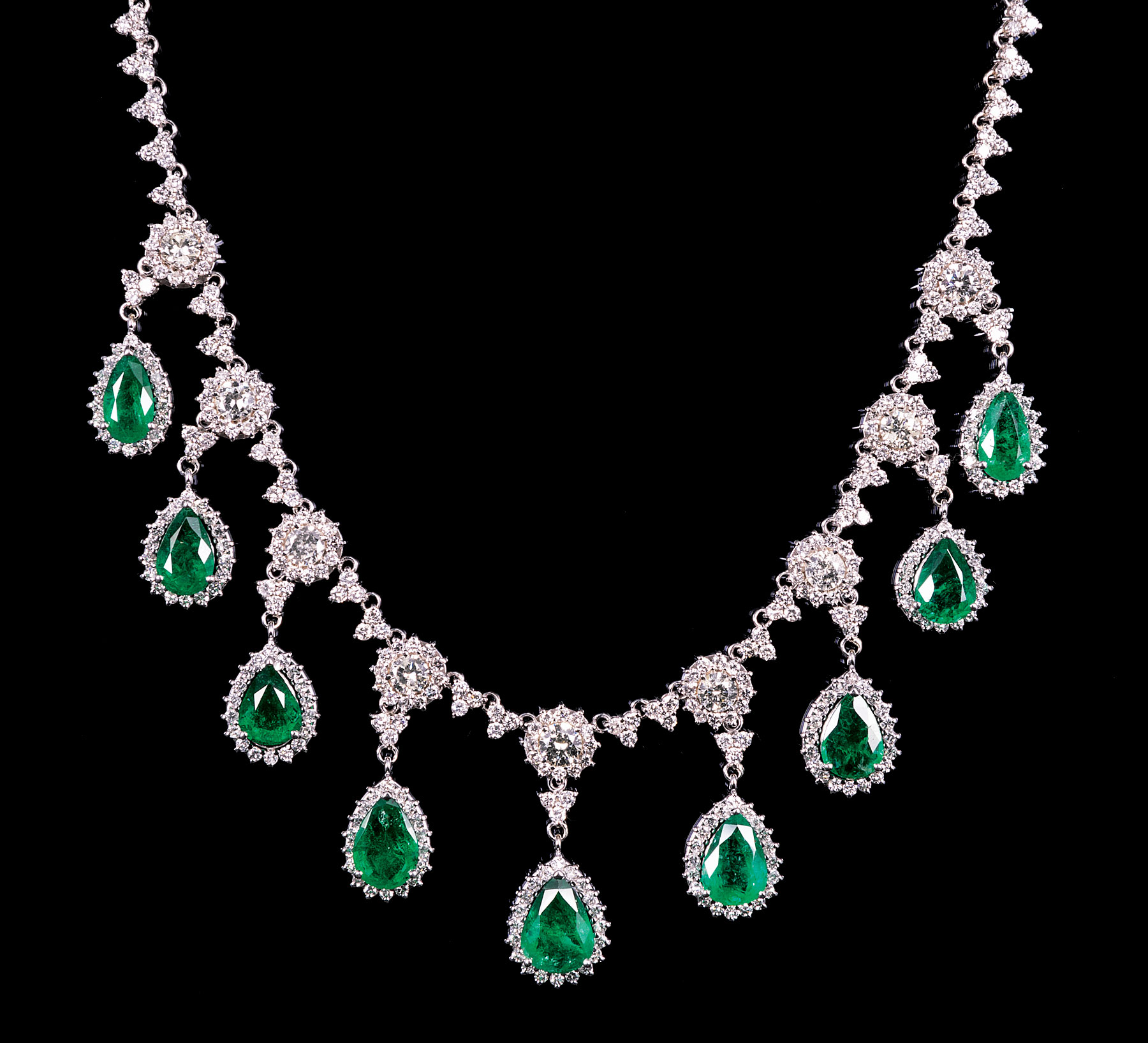 Lot 576 - 18 kt. White Gold, Diamond and Emerald Necklace , 9 pear shaped emeralds, total wt. approx. 19.93
