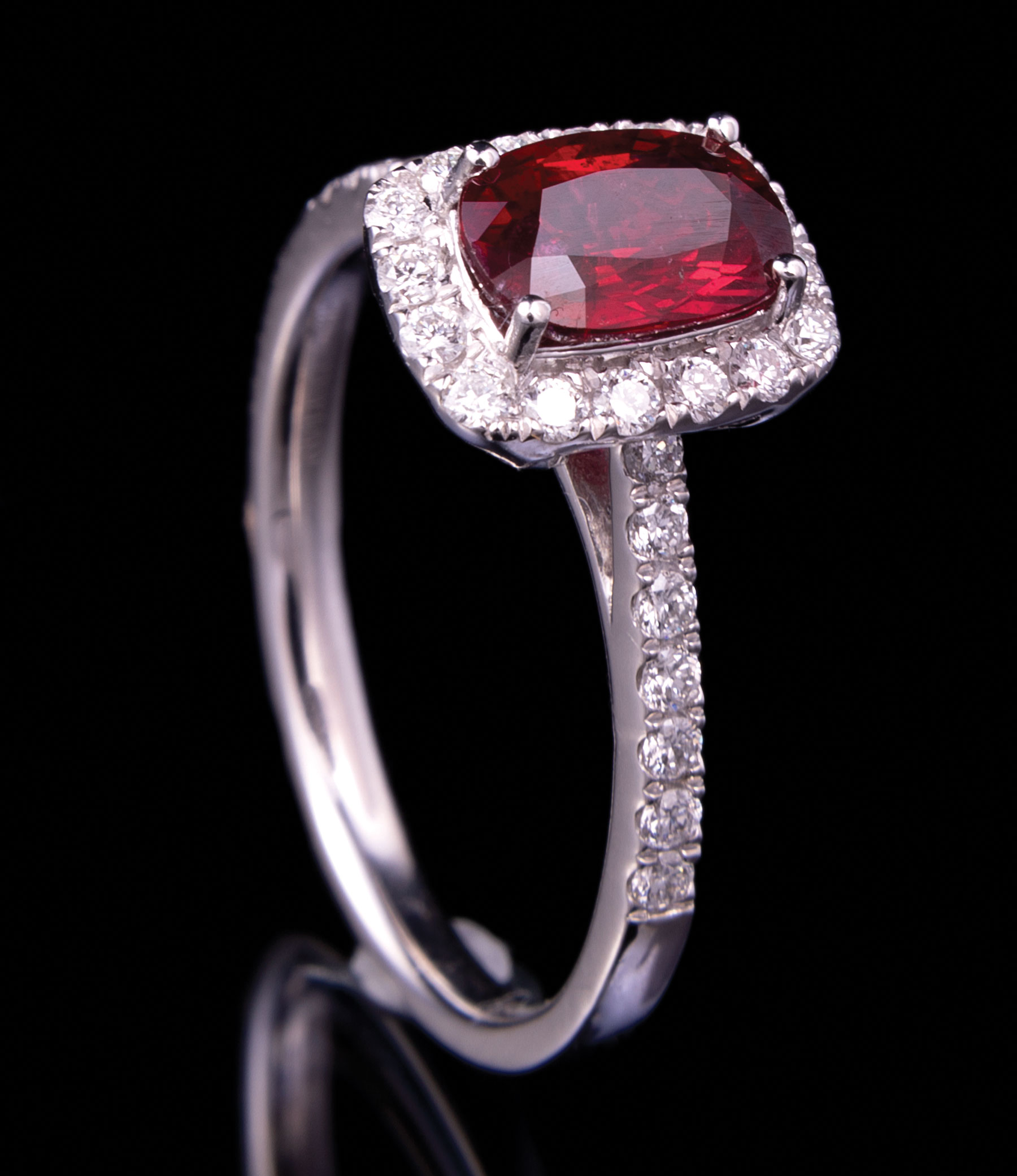 Lot 611 - Platinum, Ruby and Diamond Ring , prong set oval mixed cut ruby, 7.41 x 5.08 x 3.24 mm, exact wt.