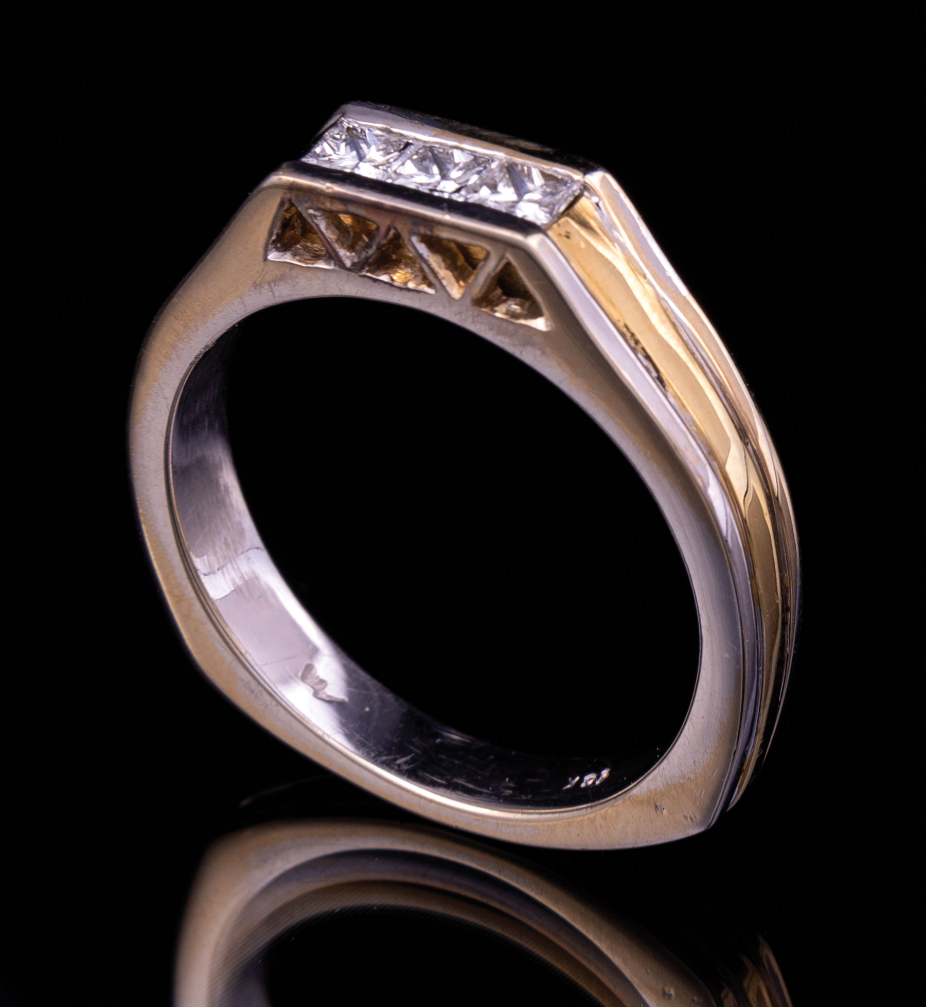 Lot 607 - 18 kt. Yellow and White Gold and Diamond Man's Ring , channel set with 3 princess-cut diamonds,