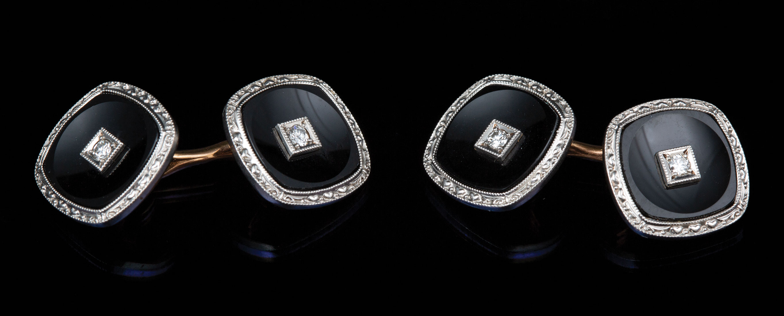 Lot 622 - Pair of 14 kt. Yellow Gold, Onyx and Diamond Cufflinks , onyx square centered by round brilliant cut