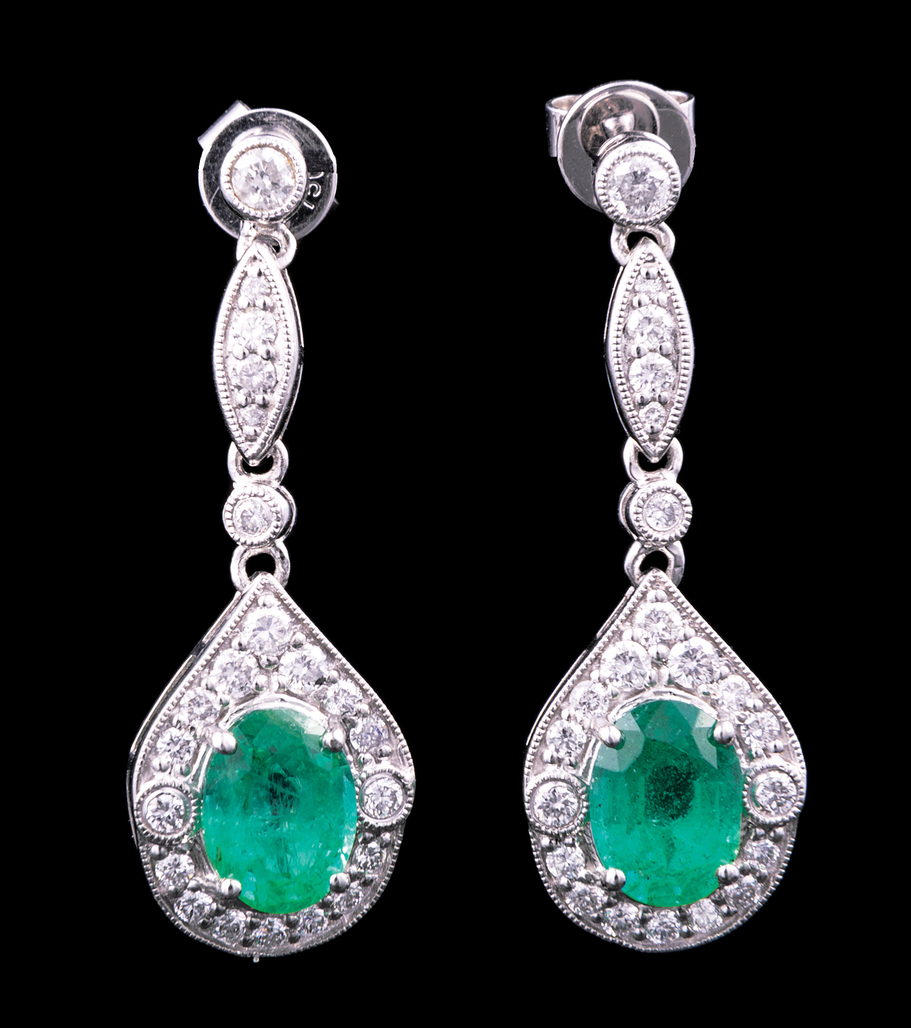 Lot 581 - Pair of 18 kt. White Gold, Emerald and Diamond Earrings , 2 prong set emeralds with brilliant cut