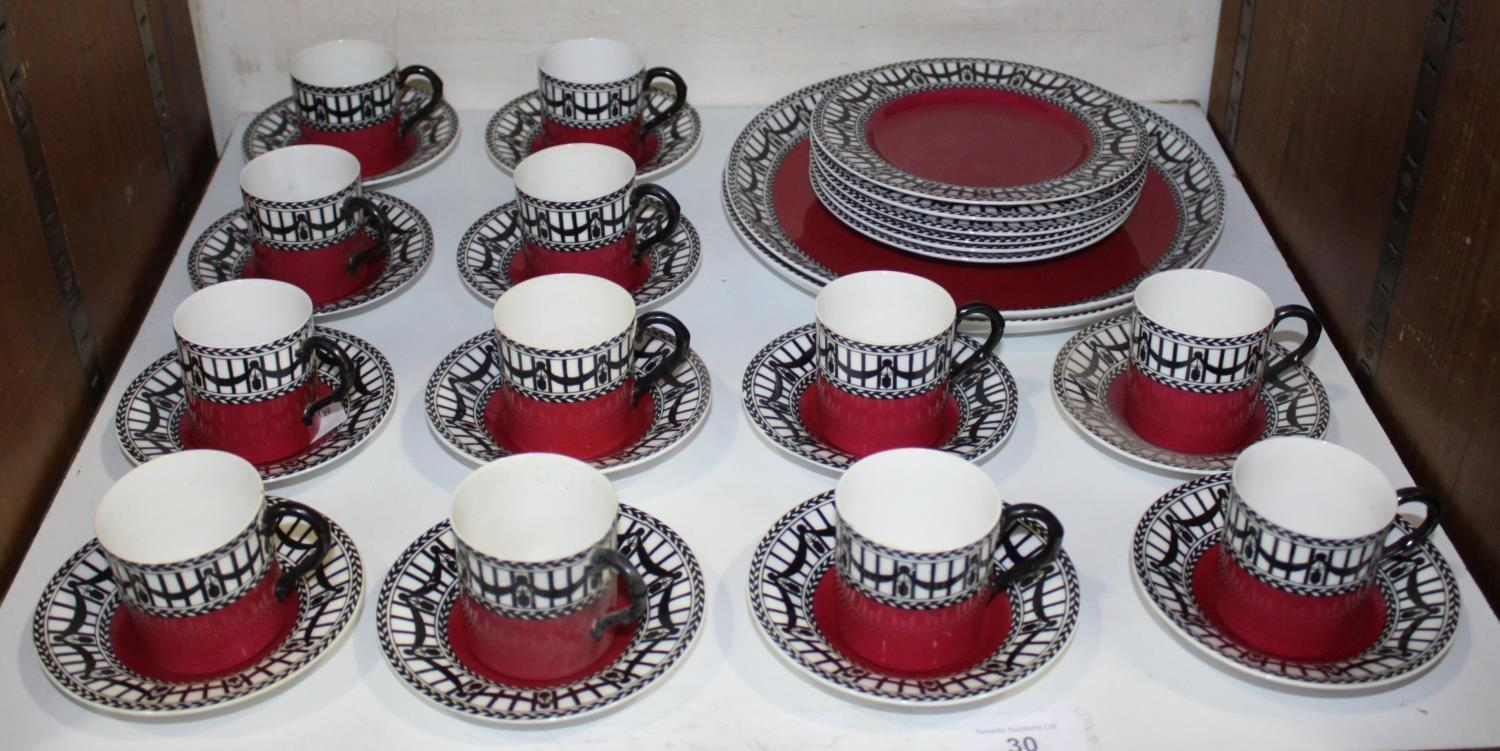 Lot 30 - SECTIONS 30 & 31. An early 20th century Royal Worcester tea and coffee set with black swags to a
