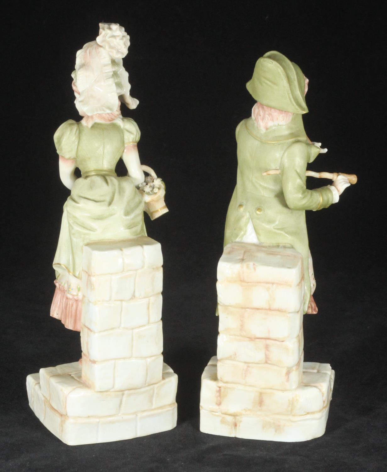 Lot 38 - A pair of Ernst Bohne and Sohne porcelain figures of a finely dressed gentleman, and a lady
