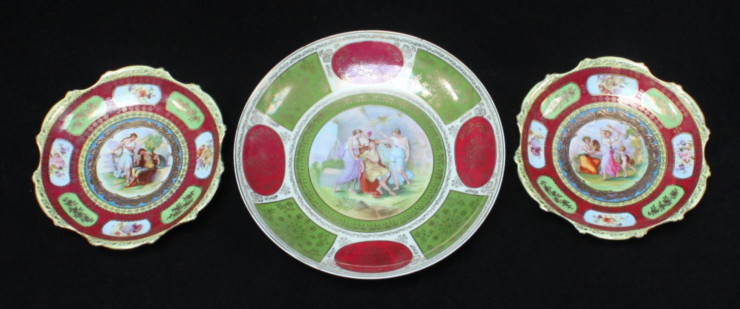 Lot 43 - Three assorted Vienna style porcelain cabinet plates, two a pair and a larger example, all with