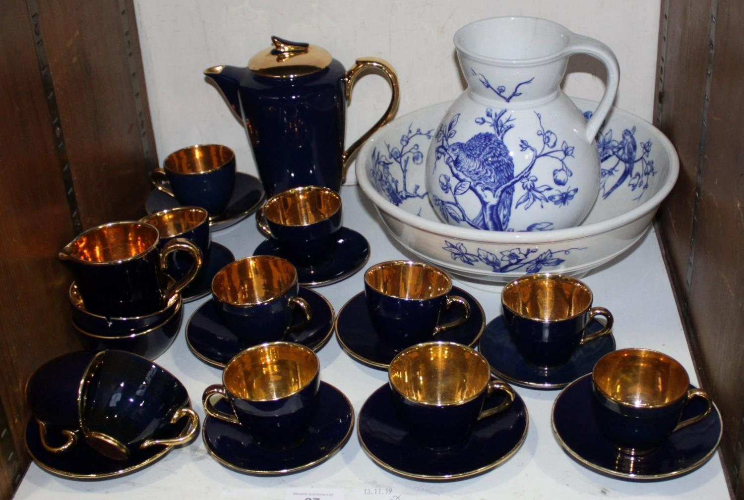 Lot 27 - SECTION 27. A Jersey Pottery blue and gilt matched part coffee set, together with a blue and white
