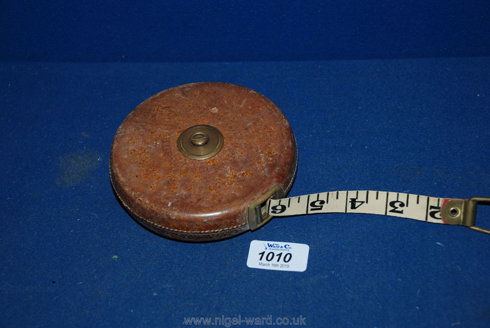 Lot 1010 - A leather Tape Measure