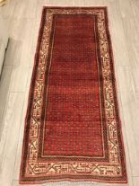 Lot 1057 - A hand-made red Bijar Runner,