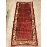 Lot 1057 - A hand-made red Bijar Runner,