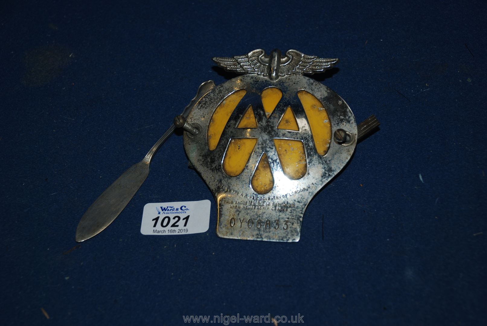 Lot 1021 - A Silver butter knife and an AA badge