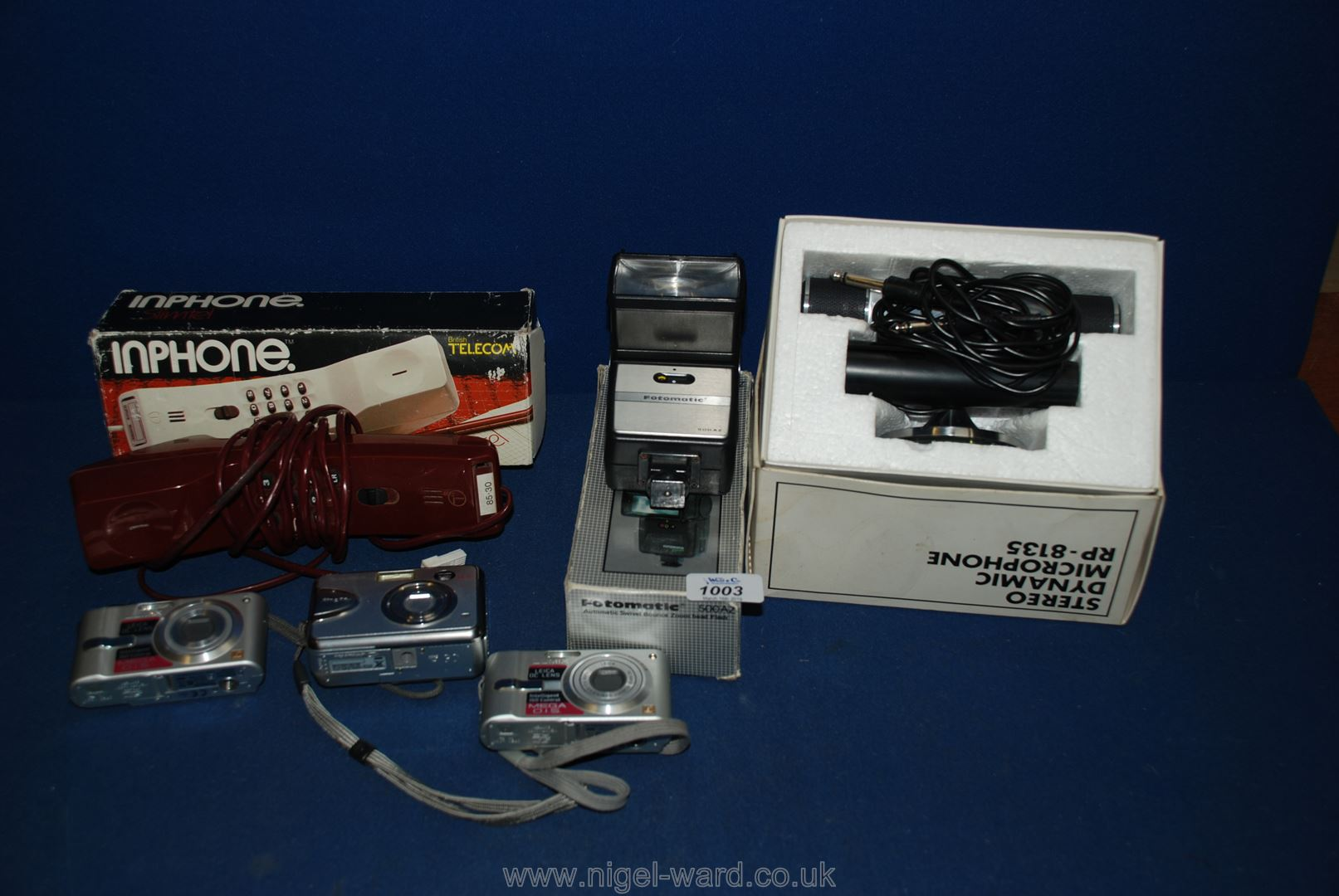 Lot 1003 - A quantity of miscellaneous including fotomatic flash, two Lumix and a Fujifilm cameras,