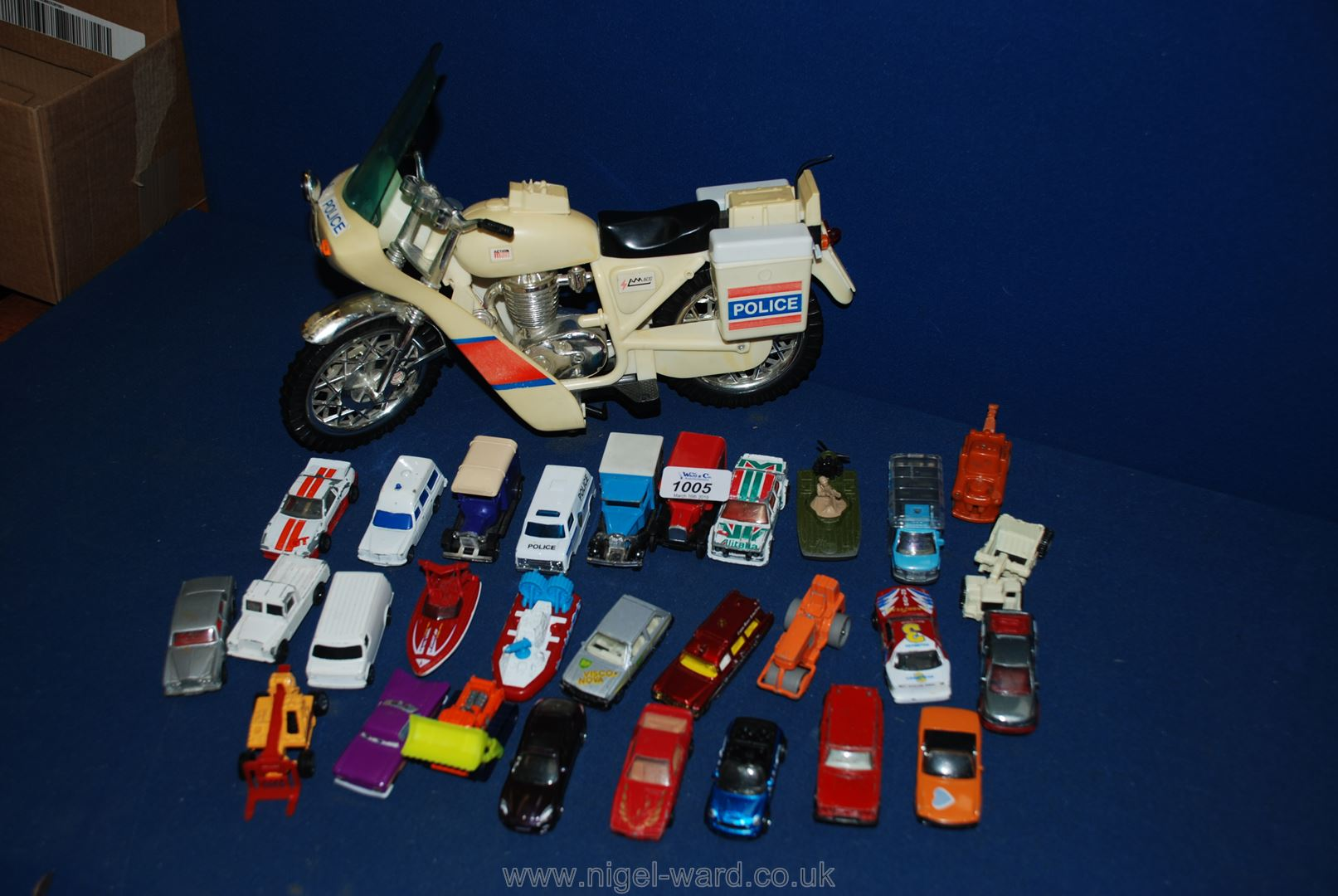 Lot 1005 - A quantity of cars including an Action Man police bike, a Corgi Ford van,