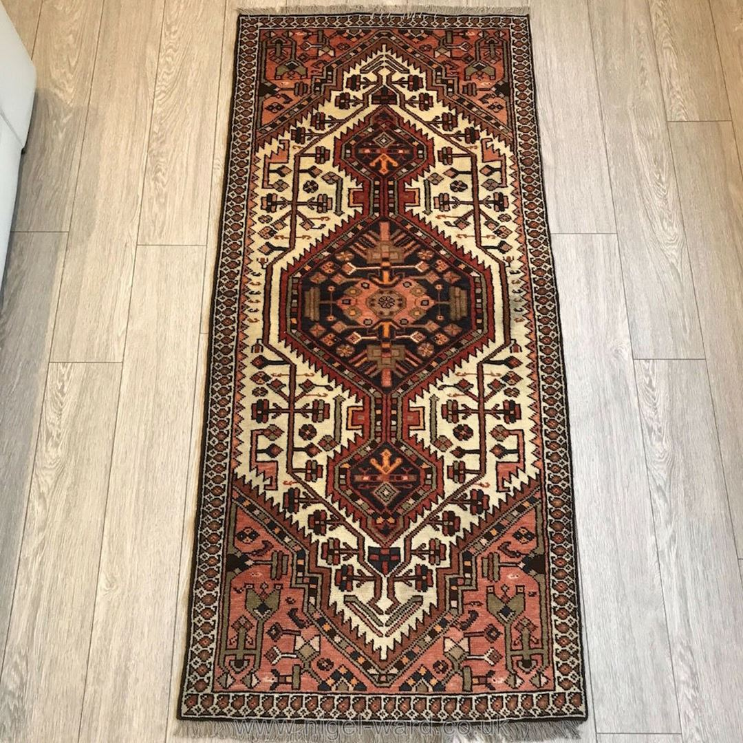Lot 1055 - A hand-made Shiraz Rug, geometric design,