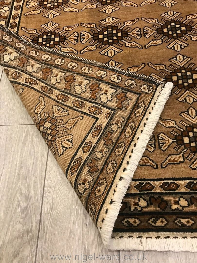 Lot 1056 - A hand-made Balouch Rug in beige,