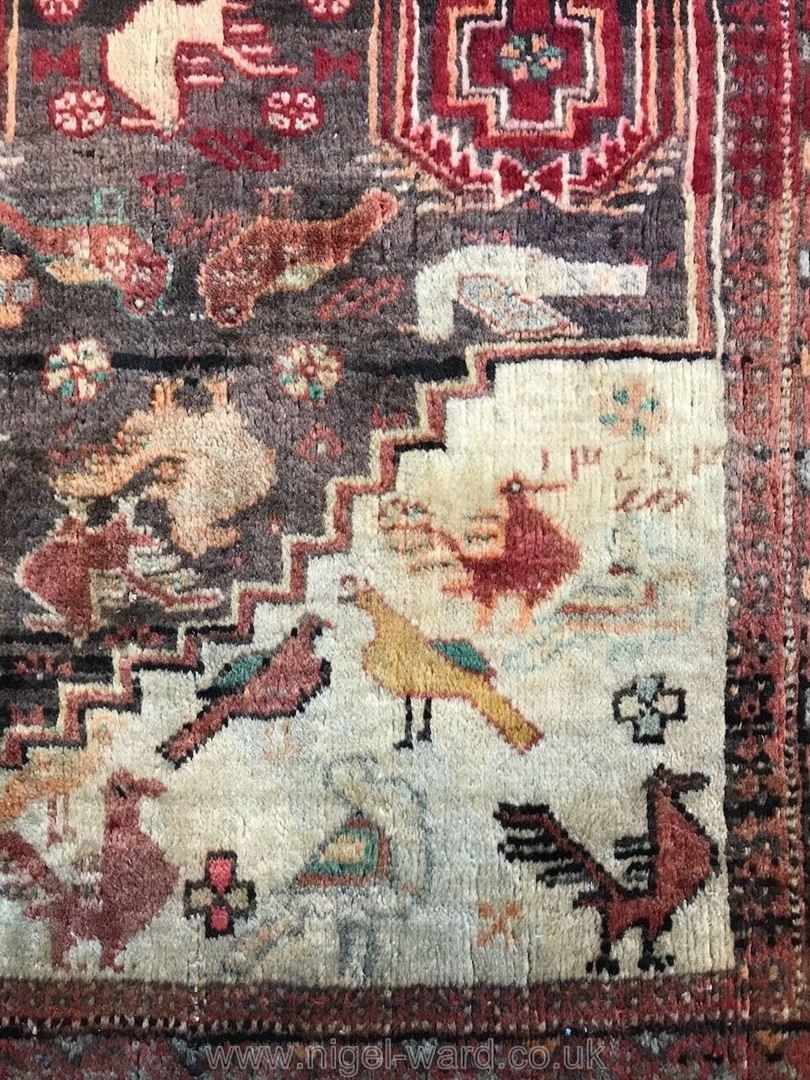 Lot 1059 - A hand-made Shiraz red Rug,