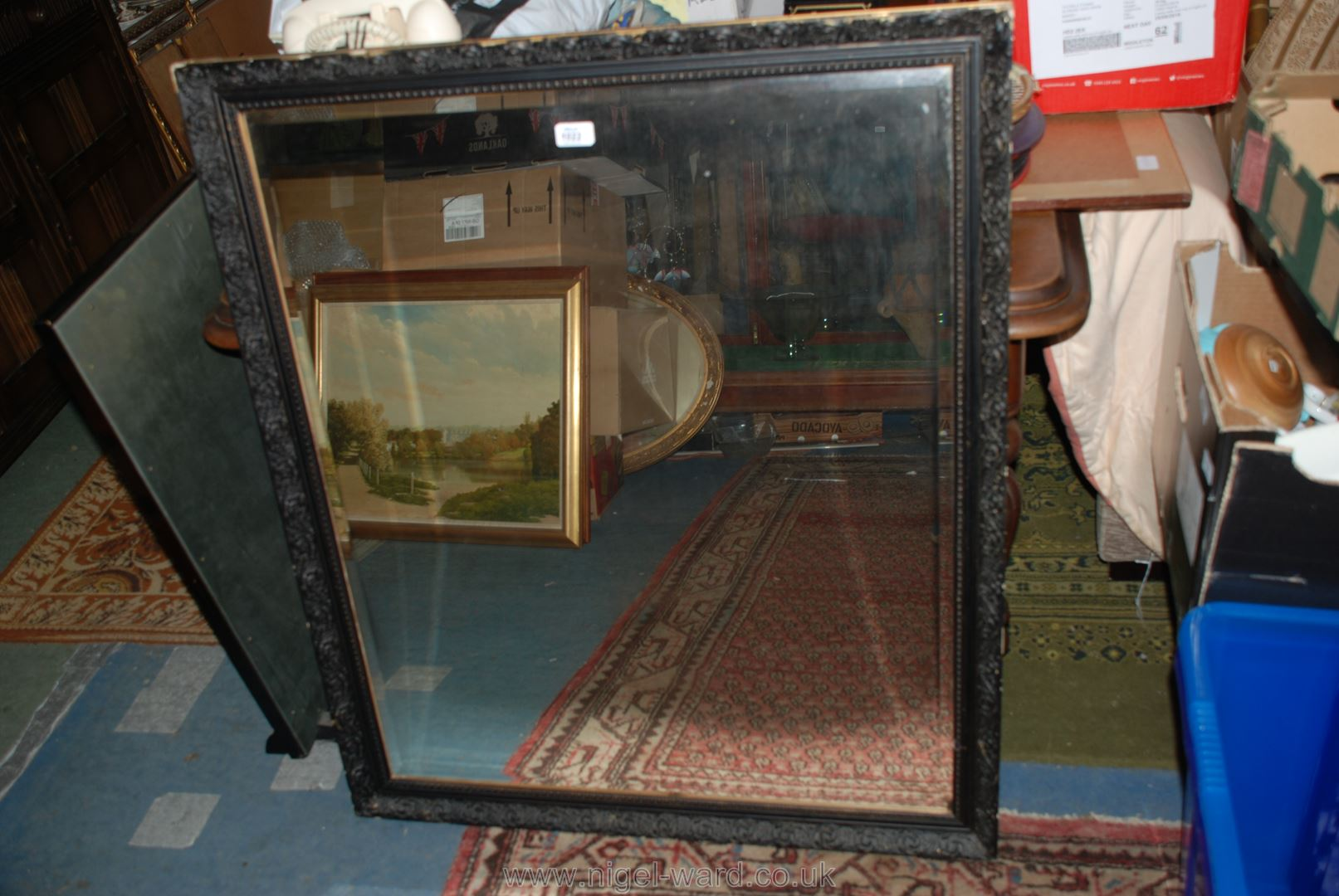 Lot 1022 - A large Mirror with black and gilt frame.