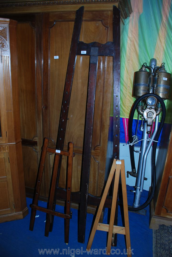 Lot 1040 - A large Victorian pine Easel dated 1887, and two smaller easels.