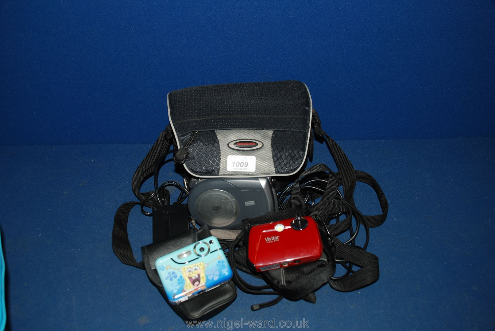 Lot 1009 - A Canon DC201 DVD Camcorder with accessories and case plus two compact digital Cameras